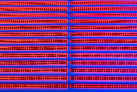 grille: Abstract image of a part of the ventilation grill with a blue and red illumination.