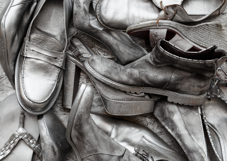 silvery: Mens and womens shoes painted completely silvery paint Stock Photo
