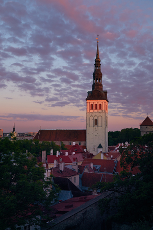 View of the tower of the Dome Cathedral and the roof of the old city at sunset in Tallinn