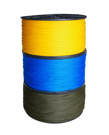 Column of three skeins of synthetic rope of yellow, blue and green colors isolated on white background