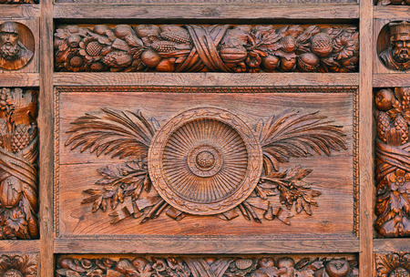Detail of a carved pattern on the wooden door of the Basilica di Santa Croce (Basilica of the Holy Cross) in Florence, Italy, travel,