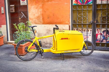 ROME - AUGUST 4: Bicycle from delivery firm -  DHL on Italian streets August 4, 2017 in Rome Italy