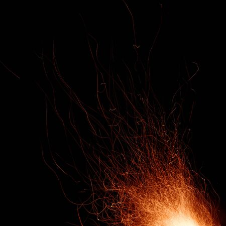 Abstract image of a fire sparks on a black background. Shot on a long exposure