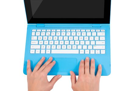 Female hands over white keyboard of blue laptop