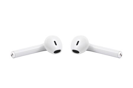 White wireless headphones isolated on white background front view. White headset