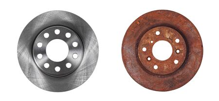 Two brake discs new and old rusty in one photo isolated on white background Foto de archivo