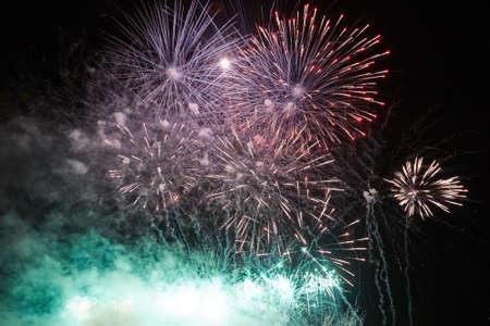 Bright colorful fireworks in the dark night sky