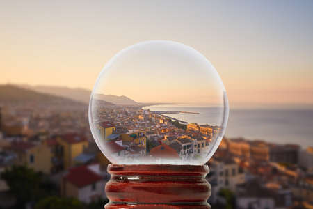 Beautiful panorama Italian seaside town - Salerno in sunrise time. The sun rises from behind the mountains and illuminates the city and the sea with its light in a glass transparent bowl Stock Photo