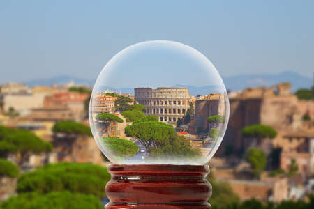 Rome skyline colosseum with blue sky in summer day through a glass transparent ball Rome, Italy