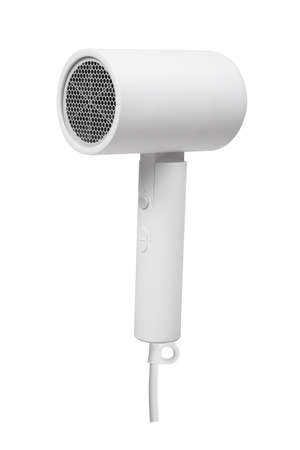 Modern hair dryer with nozzle isolated on white. Hair dryer side view isolated on white background.