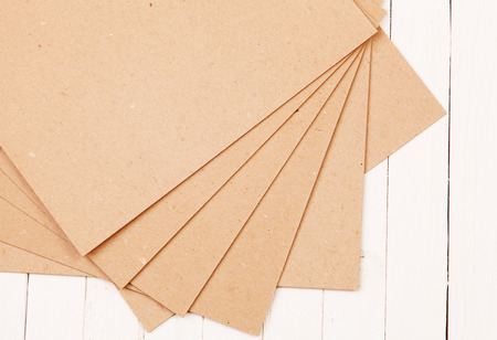 pressed: Pressed paper on wooden background
