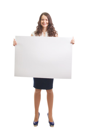Happy businesswoman holding a white banner and smiling photo