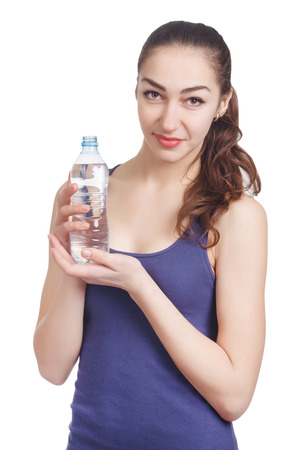 athletic girl: Beautiful athletic girl looks hold a bottle