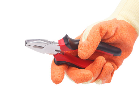 flatnose: Hand in gloves holding pliers isolated on a white background.