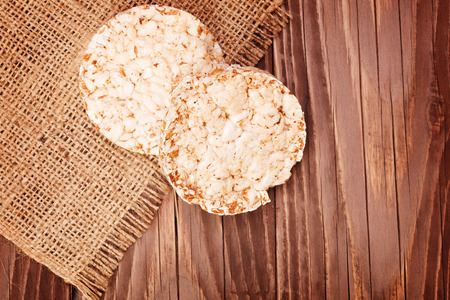 galettes: Round rice cakes on wooden table Stock Photo