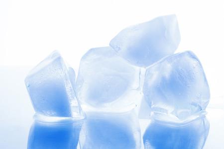 liquid reflect: Chunks of ice on a white background Stock Photo