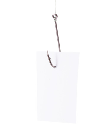 fishhook: Paper trapped in fishhook isolated over white background