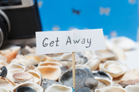 get away: Get away message on the beach - vacation and travel concept