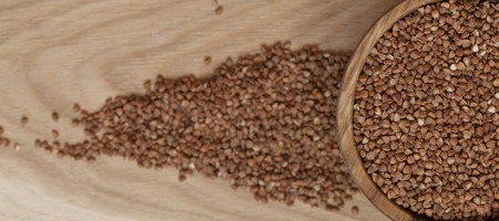 Buckwheat in a wooden plate 스톡 콘텐츠