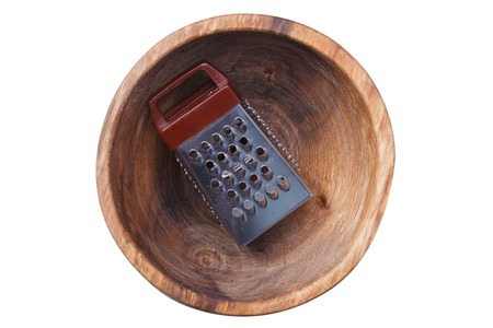 grater: Grater lies in a wooden plate Stock Photo