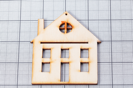 lows: graph paper with wooden house Stock Photo
