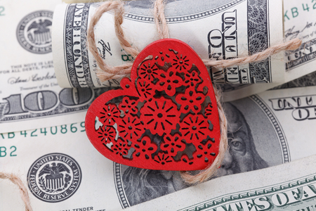 red bills: Red Heart and Hundred Dollar Bills for background