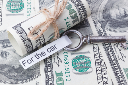 key fob: Money and business idea, The dollar bills tied with a rope, with a sign on key fob - For the car Stock Photo