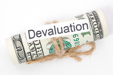 devaluation: Money and business idea, The dollar bills tied with a rope, with a sign - Devaluation