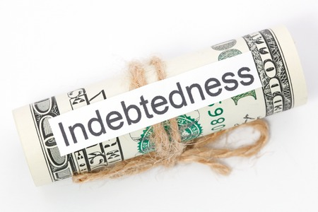 indebtedness: Money and business idea, The dollar bills tied with a rope, with a sign - Indebtedness