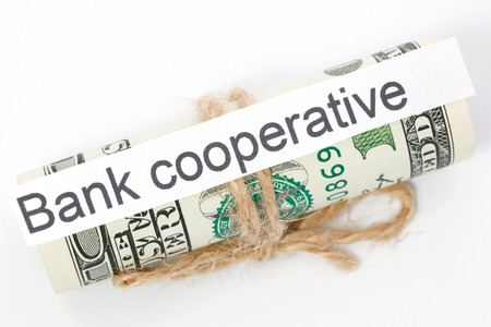 cooperativa: Money and business idea, The dollar bills tied with a rope, with a sign - Bank cooperative Foto de archivo