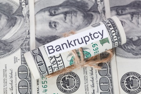 stockholder: Money and business idea, The dollar bills tied with a rope, with a sign - Bankruptcy