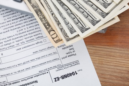 taxpayer: Money on tax form background Stock Photo