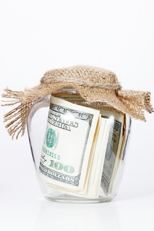meanness: Money in glass jars, isolated on white background