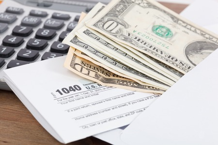 taxpayer: Tax form with calculator and Money Stock Photo