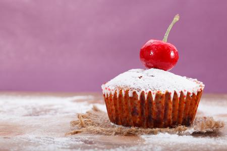 powdered sugar: Freshly baked muffin sprinkled with powdered sugar