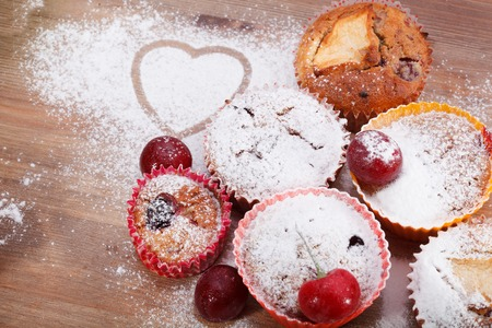 Freshly baked muffin sprinkled with powdered sugar