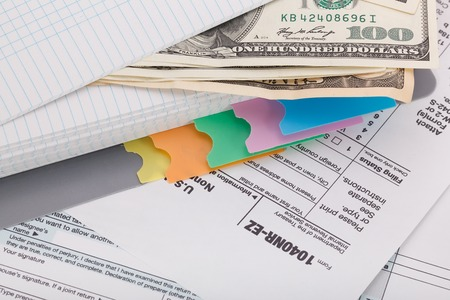 tax return: Money on tax form background Stock Photo
