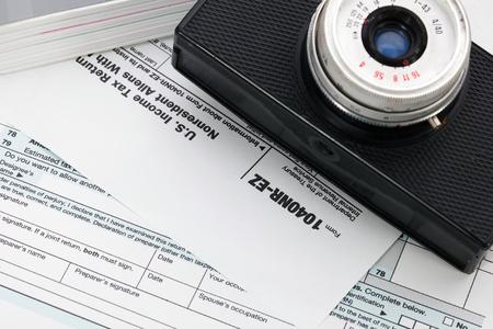 tax form: Camera on tax form background