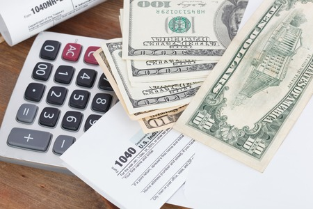 tax forms: Tax Forms with Calculator and money