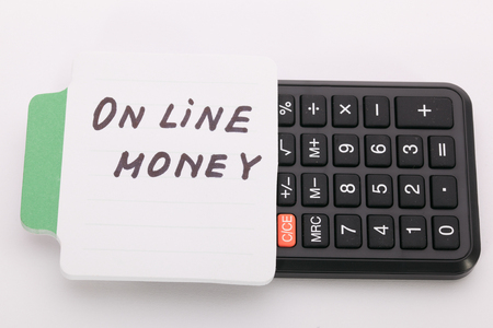 motivator: Concept write - On line money. Sign lays on calculator