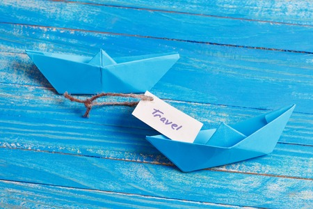 Paper Boat with a sign Travel - travel concept Stock Photo