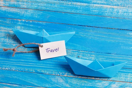 sailingboat: Paper Boat with a sign Travel - travel concept Stock Photo