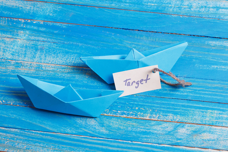 cruising: Paper Boat with a sign Target - travel concept