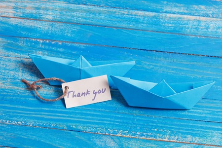 cruising: Label with the Words Thank you. Paper Boat with a sign