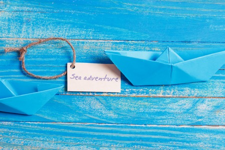Label with the Words Sea aventure which means go to trip on the yacht Stock Photo