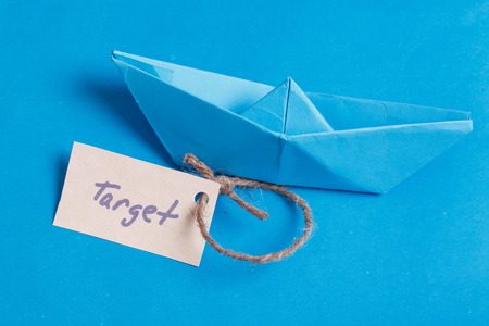 Paper Boat with a sign Target - travel concept