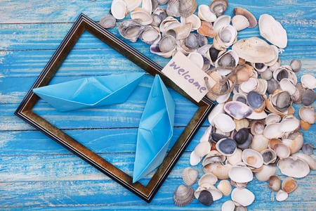 globetrotter: Paper Boat with shells and photo frame