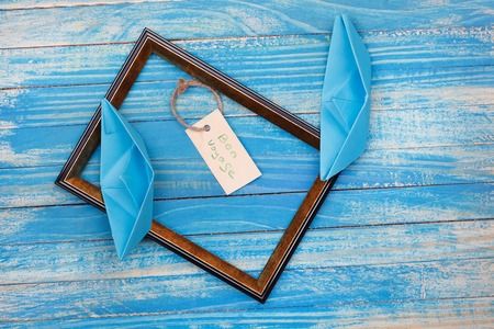 vocation: Sign Travel with shells and photo frame. Vocation background Stock Photo
