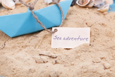 Compass in the sand with Message - Sea adventure