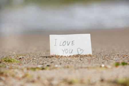 lays: I love you - sign lays on the beach Stock Photo